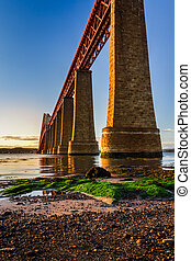 River over Forth Road Bridge at sunset