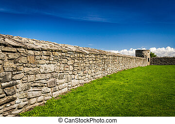 Medieval wall surrounding the castle with stone