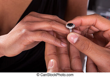 Male Hand Inserting Ring Into A Finger - Close Up Of Male...