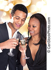African Couple Enjoying Champagne Drink - Portrait Of...