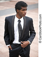 Portrait of a handsome african american fashion model in black suit