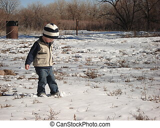 Young Boy Walking in Snow