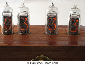 Vintage clock made with Nixie vacuum tubes using technology...