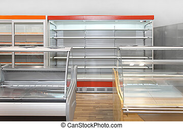 Empty market shelves - Empty retail shelves and showcases in...