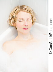 Happyness - Happy young woman relaxing in the bath