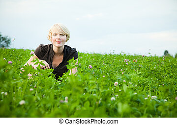 Girl in a field of flowers looking at the camera