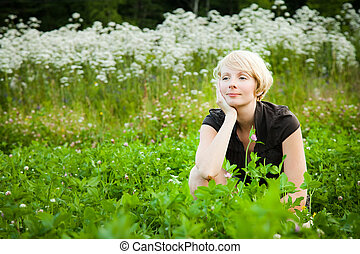 Pensive Girl in a field of flowers