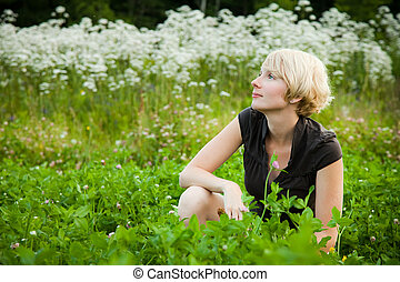 Girl in a field of flowers