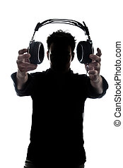 Male in silhouette showing headphones