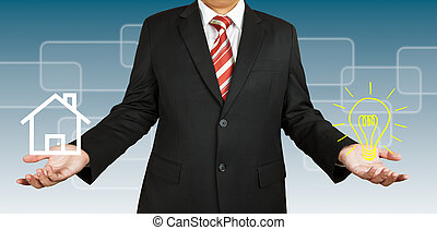 Businessman with home and idea