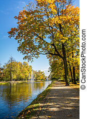 Sunny day in autumn near park and river