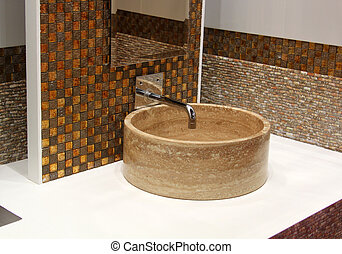 Stone washbasin and chrome tap