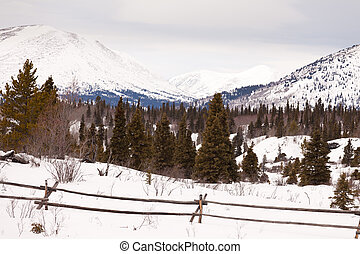 Scenic Yukon Canada winter mountains ranch fence - Snowy...