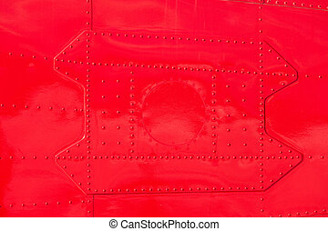Red painted riveted metal airplan