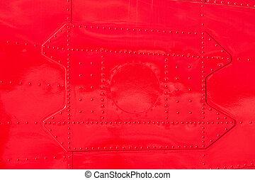 Red painted riveted metal airplane fuselage skin - Bright...