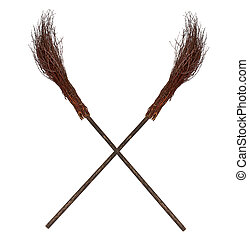 Crossed old wicked brooms isolated on white
