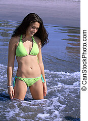 Girl on the beach - Teenage Girl standing in the water on...