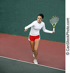 Girl playing tennis - A pretty asian teenage girl playing...