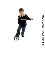 Little boy skateboards