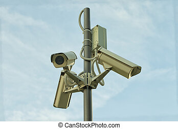 Security cameras - Pole with three security cameras over...