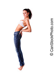Young woman in jeans and sexy bra