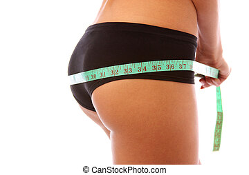 Fit girl measuring her rear to see if she has had any weight...