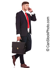very busy business man - full length picture of a young...