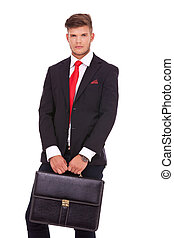 business man with briefcase - young business man holding a...