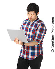 Young asian man using computer