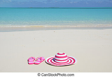 Flip-flops and hat on the beach of Exuma, Bahamas