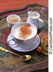 Hot milk with nutmeg - Cup of hot milk with nutmeg and brown...