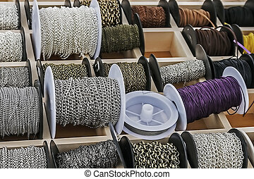 Spools with chains and colored ribbons 3 - Spools with...
