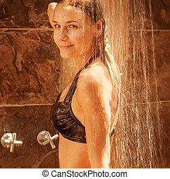 Young lady take shower - Attractive smiling young lady take...
