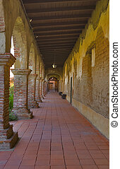 MISSION SAN JUAN CAPISTRANO ARCHES IN HALLWAY