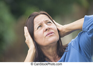 Stressed mature woman angry outdoor - Portrait attractive...