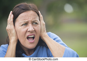Stressed angry mature woman outdoor - Portrait attractive...