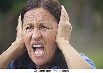 Shocked upset mature woman outdoor - Portrait attractive...