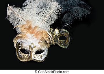 Venetian mask - Two venetian masks lying on black background