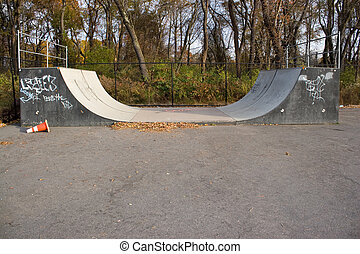 Skate Park Halfpipe - An empty halfpipe at an outdoor skate...