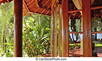 tropical jungle behind the windows of a bungalow - Bali