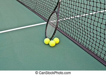 Tennis Court with racket and balls on net