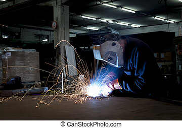 Heavy Industry - Heavy industry steel worker welding with...