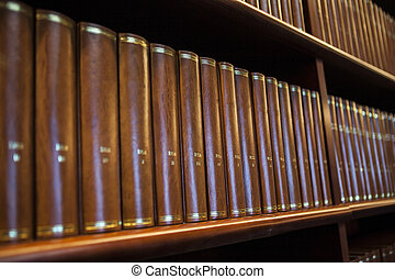 Library - Book shelf in a church library full with brown...
