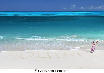 Holiday writing on the desert beach of Exuma, Bahamas