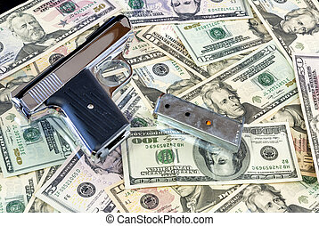 Semi Automatic Pistol on a pile of cash
