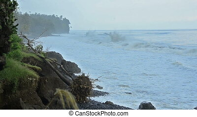 Cliff line with strong waves in Bali - East coast