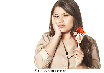 Toothache from lollipops - Girl complains of a toothache...