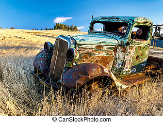 Rusty old truck in a farm field - Abandon for years and old...