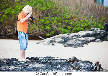 Young nature photographer - Little boy photographing marine...