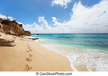 Cupecoy Beach on St Martin Caribbean - Sandstone cliffs at...
